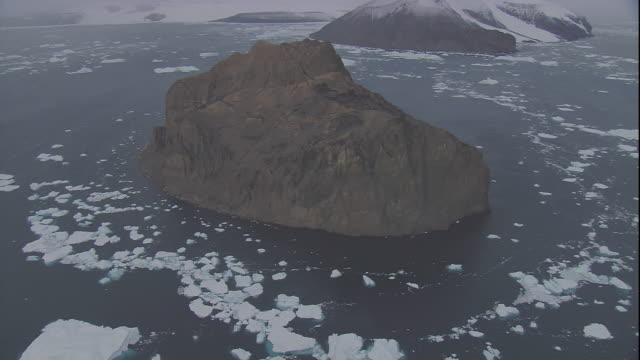 chunks of ice form a ring around islets in antarctica. - antarctic ocean stock videos and b-roll footage