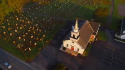 Church and cemetery at sunrise. Brodheadsville, Poconos region, Pennsylvania. Aerial drone video with the forward and tilting-down camera motion.