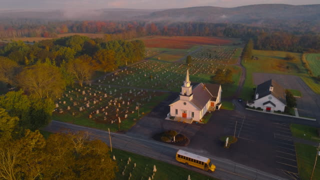 church and cemetery at sunrise. brodheadsville, poconos region, pennsylvania. aerial drone video with the forward and tilting-down cinematic camera motion. - appalachia stock videos & royalty-free footage