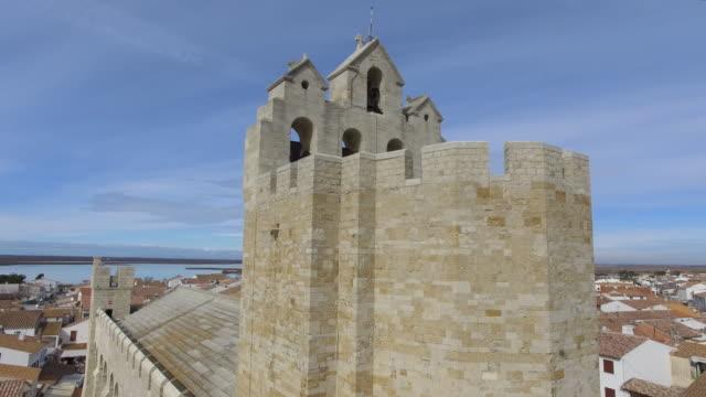Church and village of Saintes-Maries-de-la-Mer, Camargue, France - aerial view by drone