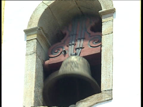 Church bell chiming in tower Ouro Preto Brazil