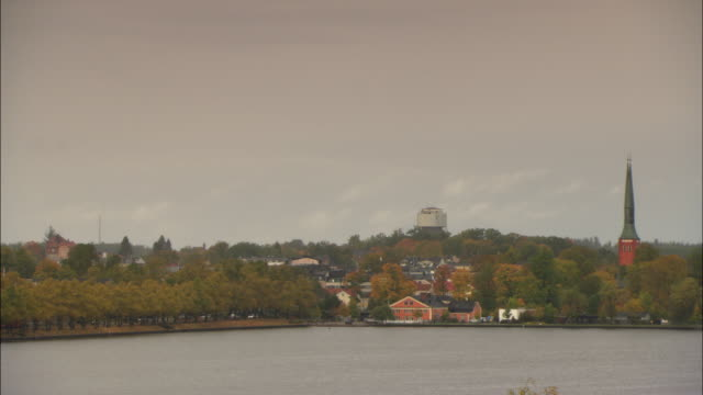 ws ha church bordering lake / vaxjo, sweden - vaxjo stock videos & royalty-free footage