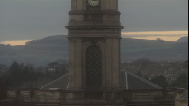a church clock tower reaches into a gray sky. - religious equipment stock videos & royalty-free footage