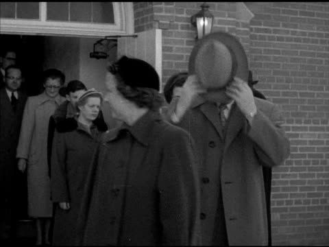 ELKHORN VS Church goers exiting church building after service Reverend Charles Burmeister saying goodbye at door shaking hands Wisconsin WI religion