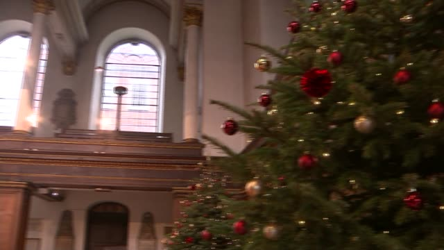 church hangs dinghy from its ceiling to remind people about the plight of the syrian refugees; **music heard sot** christmas tree dinghy hanging in... - christmas decoration stock videos & royalty-free footage