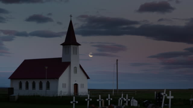 church in iceland at twilight - moon stock videos & royalty-free footage