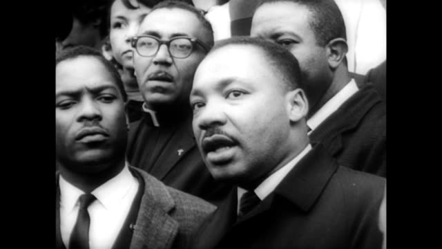 / Church in Selma AL / large group of African Americans gathered outside church / Martin Luther King Jr on steps of church addressing crowd / line of...