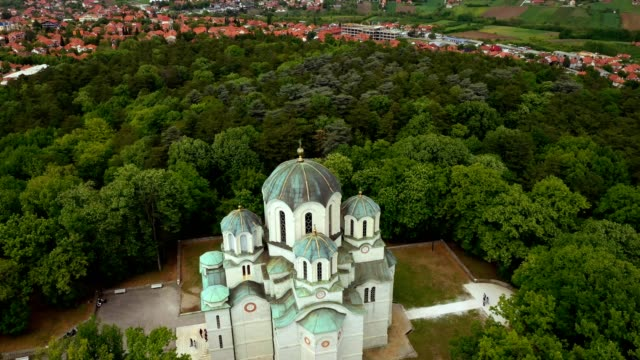 church in the woods on top of a hill..stock video - serbia stock videos & royalty-free footage