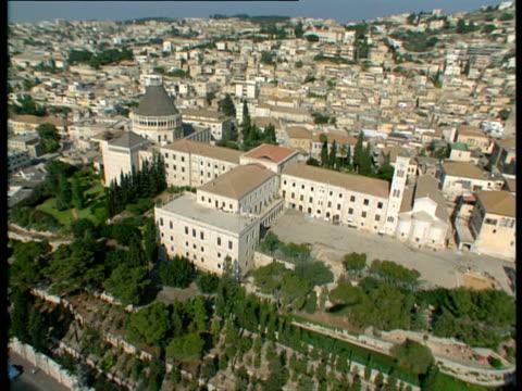 aerial ws church of annunciation in modern city of nazareth in lower galilee, israel - 聖地パレスチナ点の映像素材/bロール