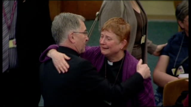 church of england general synod votes against women bishops england london church house int dr rowan williams comforting women clergy after vote... - comforting colleague stock videos & royalty-free footage