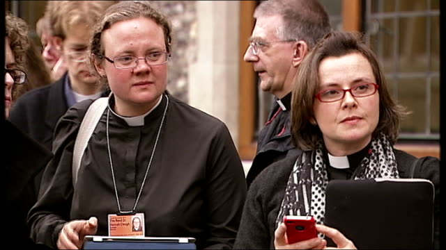 church of england general synod votes against women bishops; various of women clergy standing outside building - synod stock videos & royalty-free footage