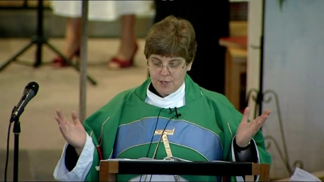 church of england general synod votes in favour of ordaining women bishops; england: int female priest speaking at lectern sot stained glass window... - priest stock videos & royalty-free footage