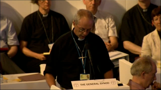 church of england general synod votes in favour of ordaining women bishops int man speaking at podium for 'the general synod' high angle view people... - man and machine stock videos & royalty-free footage