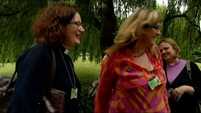 church of england general synod votes in favour of ordaining women bishops york woman priest hugging another woman clergywoman toasting with plastic... - priest stock videos & royalty-free footage