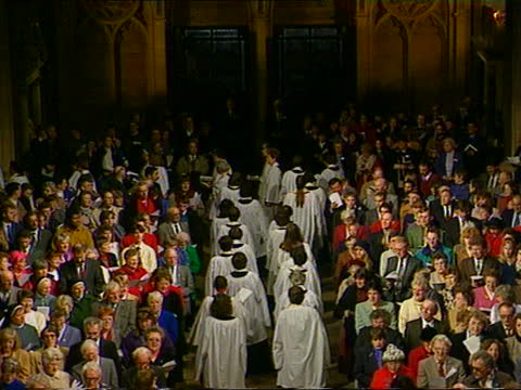 ordination of women priests; a) england: bristol: bristol cathedral: ext gv bristol cathedral cms women arriving to be ordained towards and past... - moving up点の映像素材/bロール