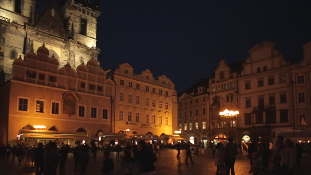 church of our lady & restaurants in the old town square at dusk, prague, czech republic, europe - stare mesto stock videos and b-roll footage