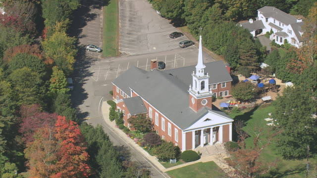 aerial church of our redeemer amid fall colored trees / lexington, massachusetts, united states - lexington massachusetts stock videos & royalty-free footage