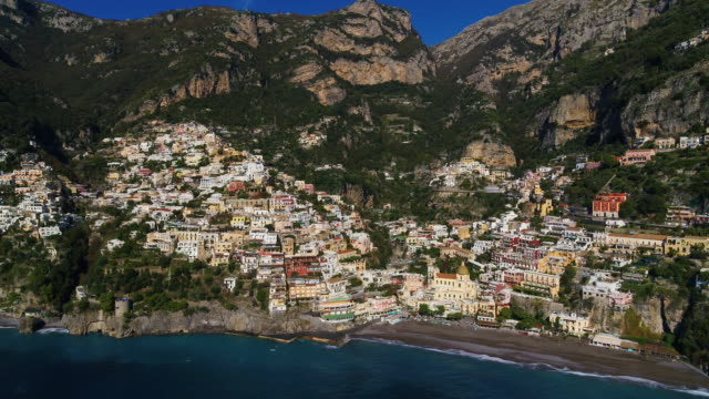 church of santa maria assunta and multicoloured cliffside houses on mountainside, positano, amalfi coast, italy - mediterranean sea stock videos & royalty-free footage