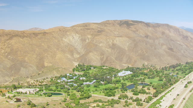 WS AERIAL POV Church of Scientology's Gold Base compound against foothills of San Jacinto Mountains / Gilman Hot Springs, California, United States