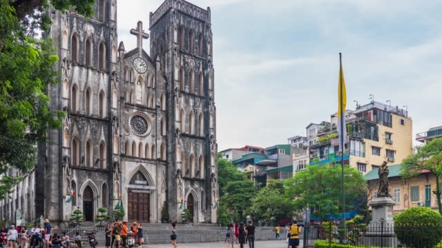 church of st. joseph in hanoi with tourisms, time lapse video - vietnam video stock e b–roll