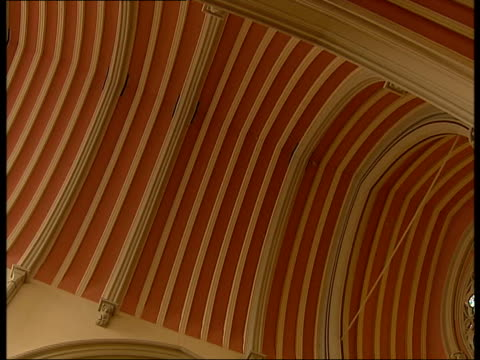 london tower hill int light shining through round stained glass window / low angle shots of arched ceilings and stained glass windows / church pews... - altar stock videos & royalty-free footage