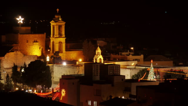 church of the nativity and bethlehem star at night bethlehem, westbank, palestine. time lapse. - church of the nativity stock videos and b-roll footage