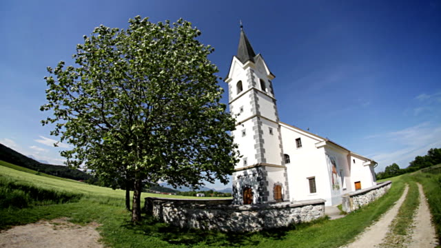 church on a green field - mgost stock videos and b-roll footage