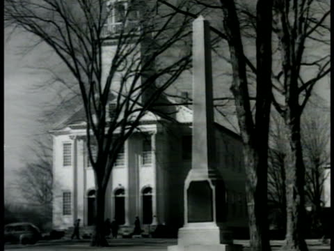 Church on tree lined street WS Same columned steeple church w/ obelisk monument FG People middleaged adults in coats women in hats walking into...