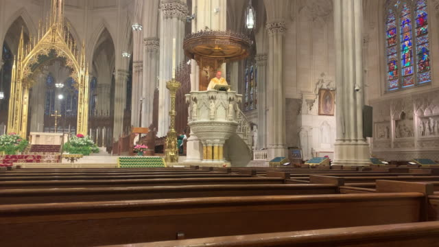 church pews stand empty as cardinal timothy dolan, the archbishop of new york, celebrates easter sunday mass in a nearly empty st. patrick's... - cathedral stock videos & royalty-free footage