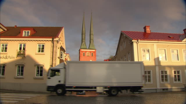 ws church rising between two buildings / vaxjo, sweden - vaxjo stock videos & royalty-free footage