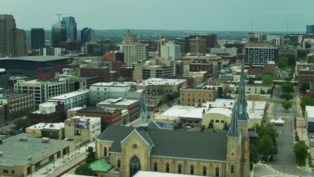church spire and cityscape of grand rapids, michigan - aerial - church stock videos & royalty-free footage