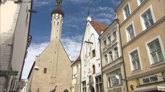 church spire and market, tallinn, estonia - estonia stock videos & royalty-free footage
