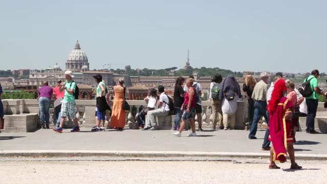 a church spire can be seen between trees above rome italy on friday may 29 2015 shots skyline with the altare della patria tourists take selfies and... - altare della patria stock videos and b-roll footage