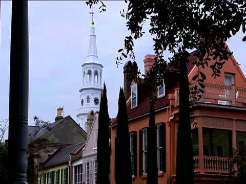 church spire stands above historical buildings - spire stock videos & royalty-free footage