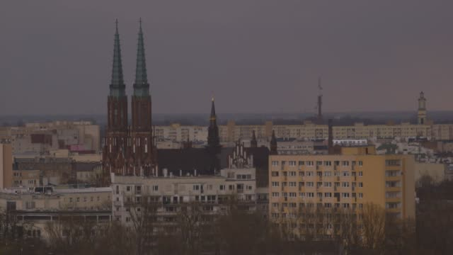 church spires rise above apartment buildings, warsaw - 20世紀のスタイル点の映像素材/bロール