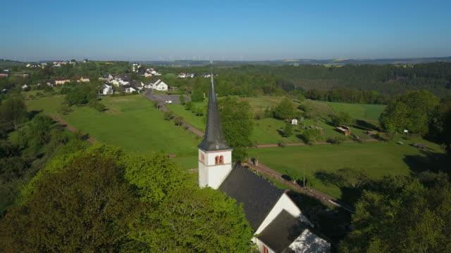 church st. johannes in kastel-staadt, saar valley, rhineland-palatinate, rheinland-pfalz germany - rheinland pfalz stock-videos und b-roll-filmmaterial