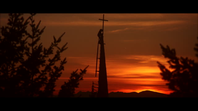 ms church steeple being built at sunset / unspecified  - letterbox format stock videos and b-roll footage