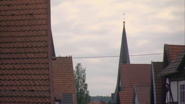 ms church steeple rising above several rooftops / kassel, germany - steeple stock videos & royalty-free footage