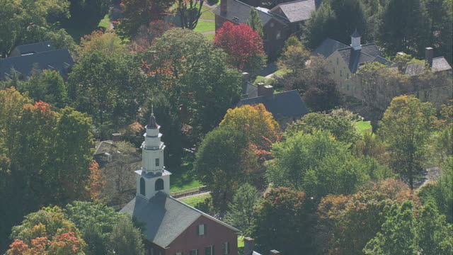 aerial church steeple rising above surrounding fall foliage and trees / deerfield, massachusetts, united states - deerfield massachusetts stock videos & royalty-free footage