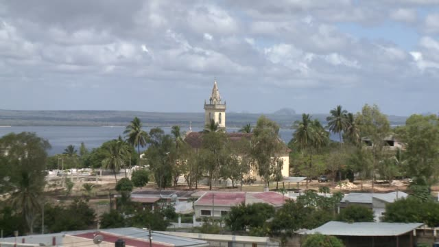 a church steeple towers over a coastal town in madagascar. available in hd. - steeple stock videos & royalty-free footage