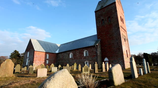 church with cemetery - kirche stock videos and b-roll footage