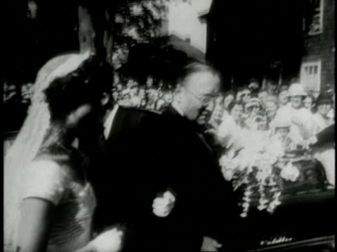 church with crowd gathered in front / jacqueline kennedy onassis arriving at the church with her stepfather hugh d auchincloss - jacqueline kennedy stock videos and b-roll footage