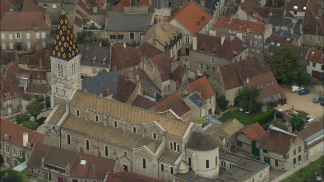 AERIAL WS Church with tiled steeple and surrounding buildings / Nuits-Saint-Georges, France