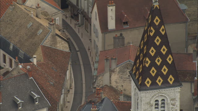 AERIAL CU ZO WS Church with tiled steeple and surrounding buildings / Nuits-Saint-Georges, France