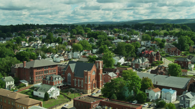 churches and houses in connellsville, pennsylvania - street name sign stock videos & royalty-free footage