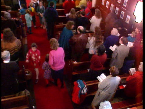 vídeos y material grabado en eventos de stock de churches to advertise england staffs christ's church gentleshaw seq evangelical service underway as congregation singing amp clapping ms side woman... - artículo de montañismo