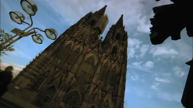 churchgoers enter and exit the cologne cathedral. - catholicism stock videos & royalty-free footage