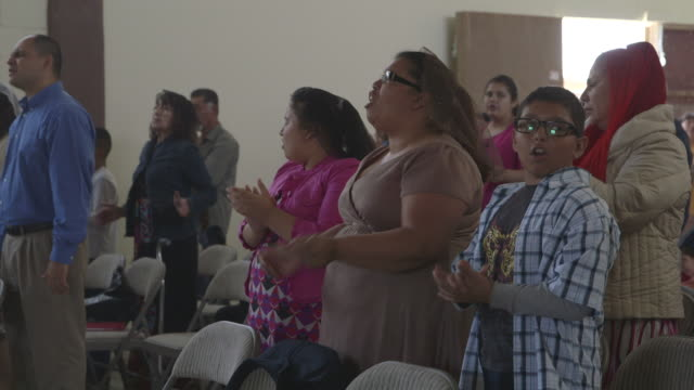 vidéos et rushes de churchgoers singing, medium shot - religion