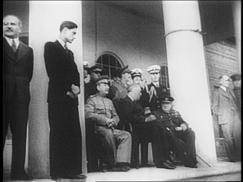 churchill poses, walks up steps to meet stalin at top/ george c marshall, ernest j king, vladimir pavlov, henry arnold stand at top/ chairs set up,... - 1943 stock-videos und b-roll-filmmaterial