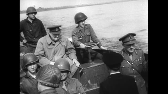 churchill rides in craft crossing river us and british officers and us soldiers riding in craft with him us soldier next to him steering / [note... - rhein stock-videos und b-roll-filmmaterial
